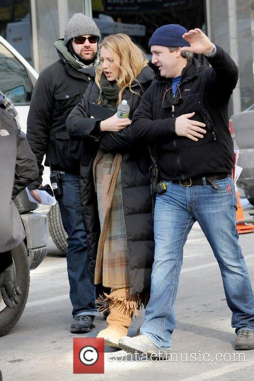 Blake Lively being ushered by crew members to...