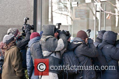 Extras Extras playing paparazzi are seen on the...