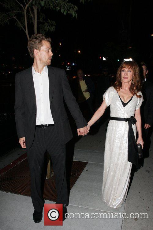 Kathy Griffin holds hands with a man at...