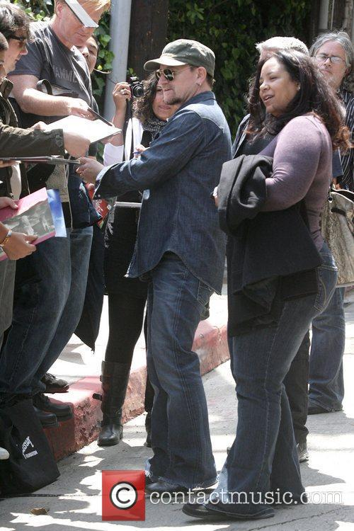 Signs autographs for fans outside the Chateau Marmont...