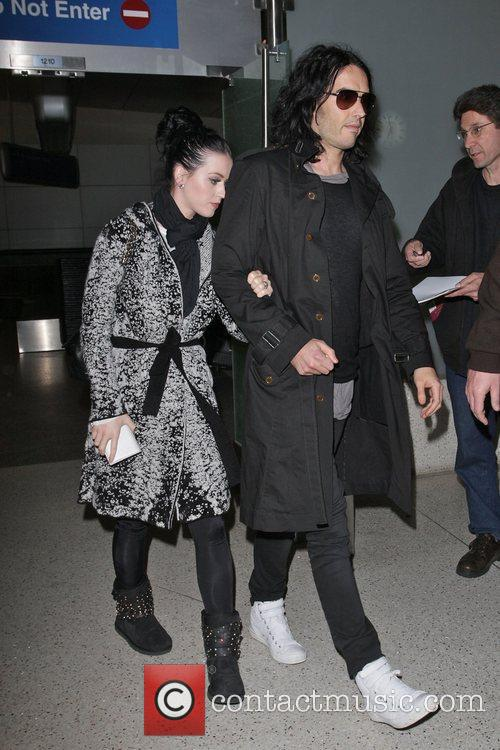 Katy Perry and Russel Brand arriving at LAX...