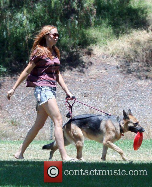 Brandi Cyrus in Griffith Park playing with her...
