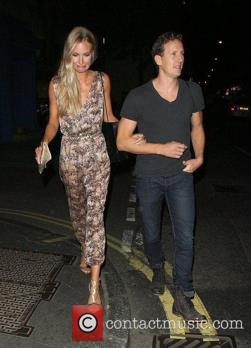 Brendan Cole and his wife Zoe Hobbs walking...