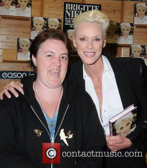 Brigitte Nielsen and a fan Brigitte Nielsen signs...
