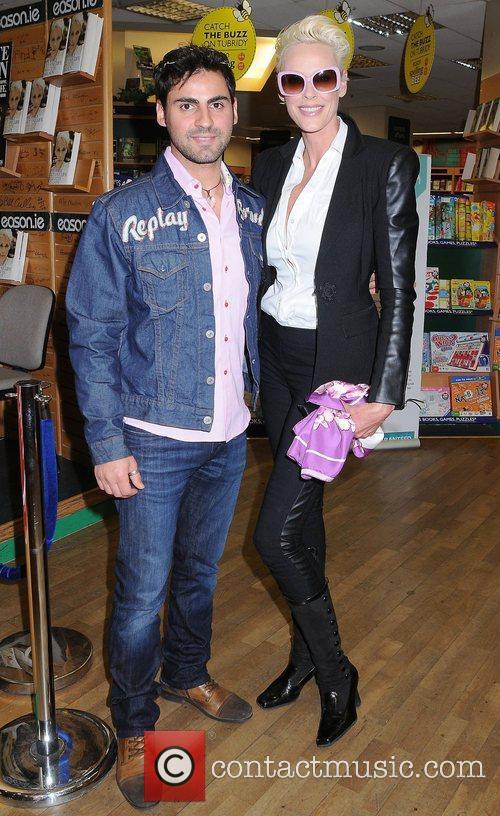 Brigitte Nielsen and Mattia Dessi Brigitte Nielsen signs...