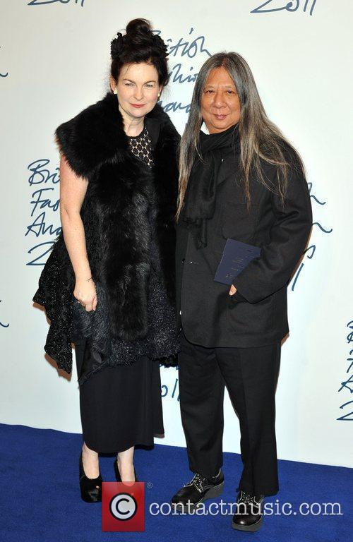 John Rocha and guest 2011 British Fashion Awards...