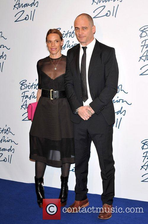 Dinos Chapman and guest 2011 British Fashion Awards...