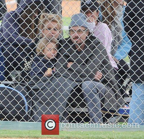 Attending her son Sean Preston's little leage baseball...