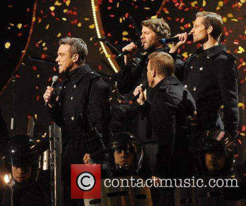 Robbie Williams Reunites With Take That At Brits Icon Gig