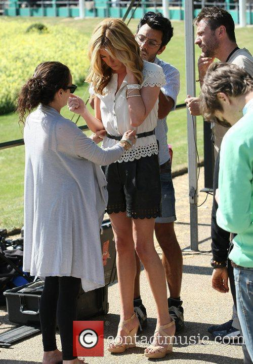 Cat Deeley filming outside Buckingham Palace during preparations...
