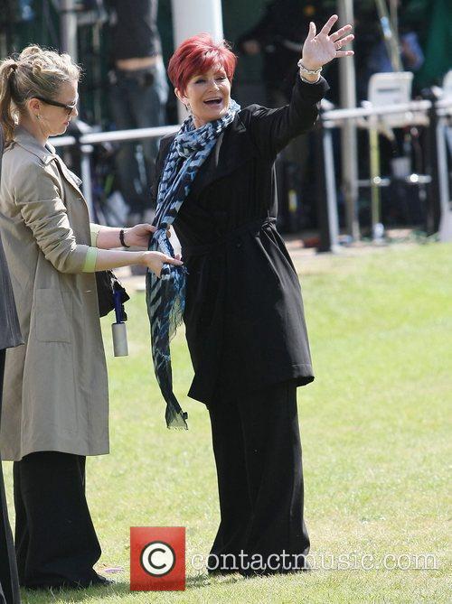 Sharon Osbourne filming outside Buckingham Palace during preparations...