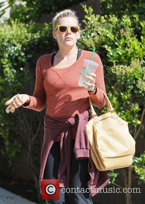 Leaving her personal trainer's house in her workout...
