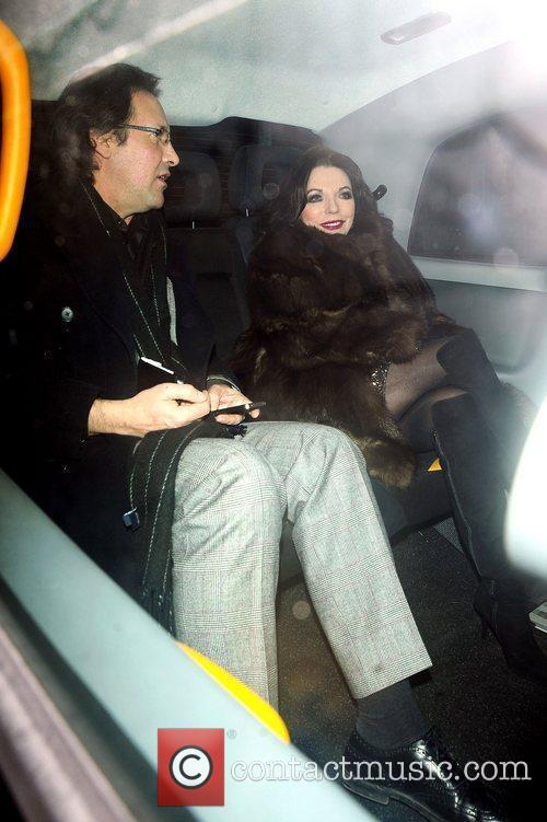 Joan Collins and Percy Gibson leave C London...