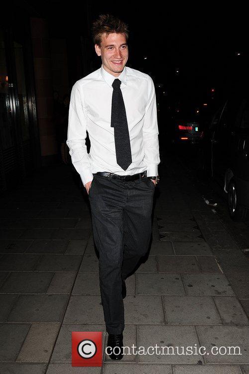Arsenal footballer Nicklas Bendtner leaving C London restaurant...