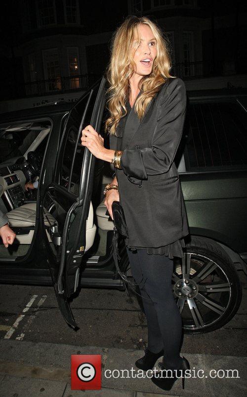 Elle Macpherson leaving C London restaurant after dining...