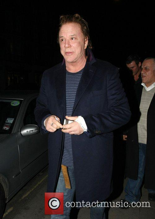 Mickey Rourke leaves C London restaurant in a...