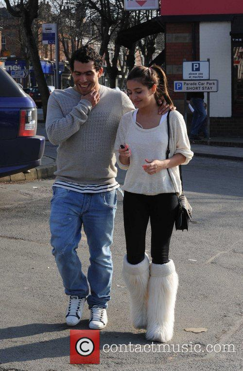 Carlos Tevez and a female companion  after...
