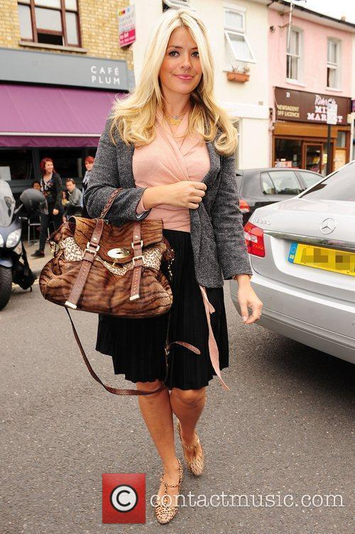 Holly Willoughby Celebrities arrive for the filming of...