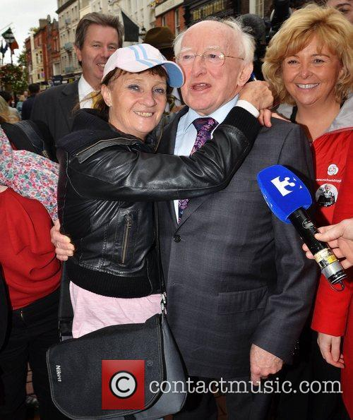 Michael D Higgins hugs Ann Morgan out and...