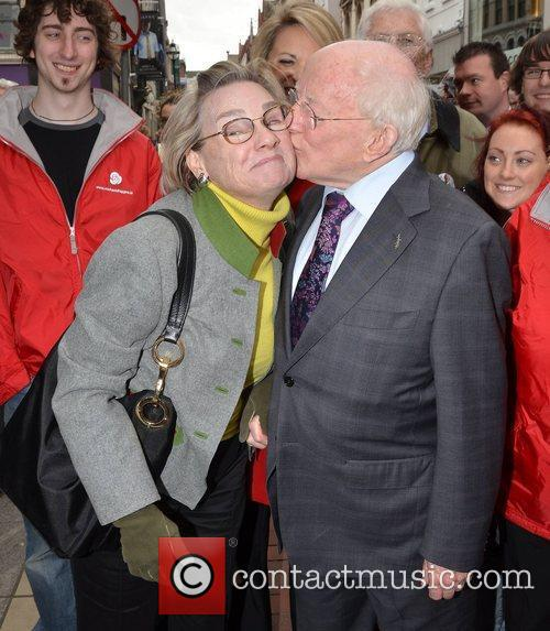 Michael D Higgins kisses Mary O'Neill out and...