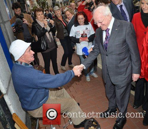 Michael D Higgins meets Busker out and about...