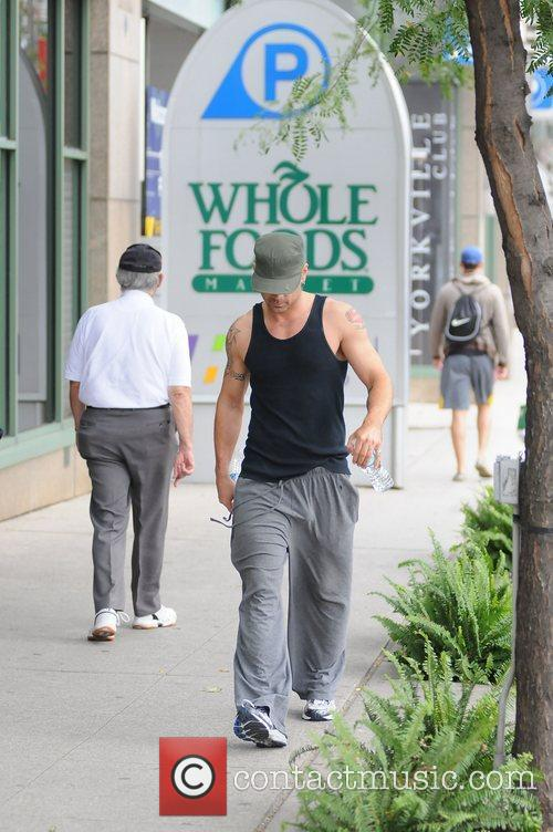 Colin Farrell is seen walking in his gym...