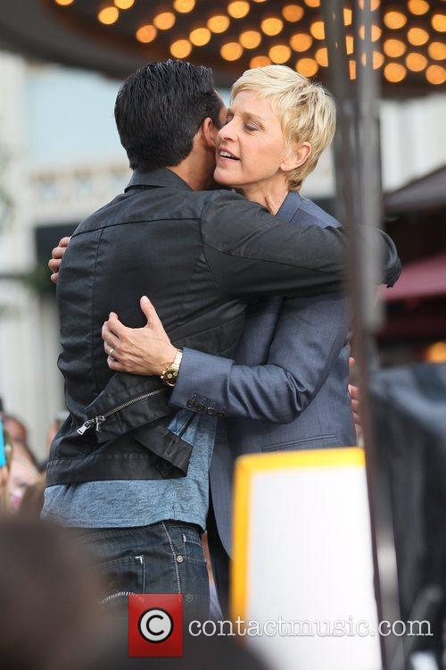 Ellen DeGeneres hugs Mario Lopez at The Grove...