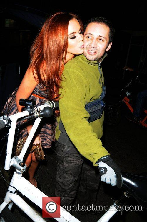 Maria Fowler kisses the pedicab driver as she...