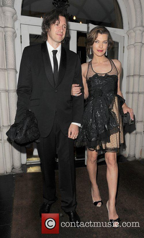 Milla Jovovich and Paul W. S. Anderson leaving...