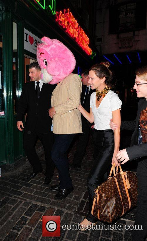 Stephen Fry wearing an oversized pink Care-Bear head...