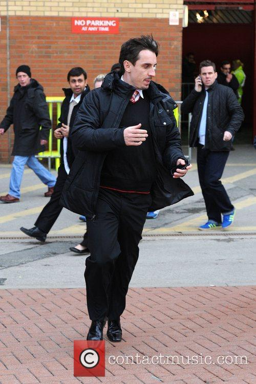 Gary Neville leaving Old Trafford after watching the...