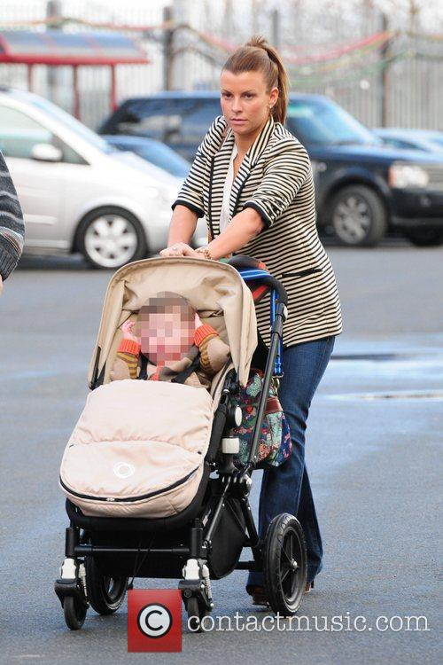 Coleen Rooney arrives at Old Trafford with her...