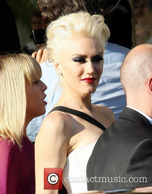 Gwen Stefani Celebrities leaving the Martinez Hotel during...