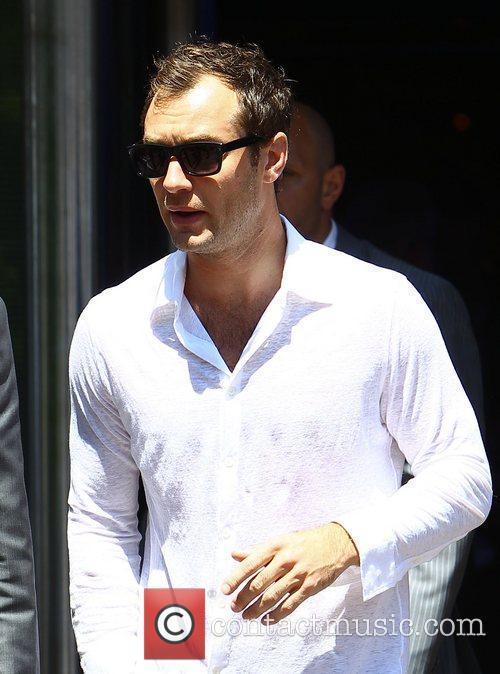 Jude Law leaving the Palais de Festivals during...