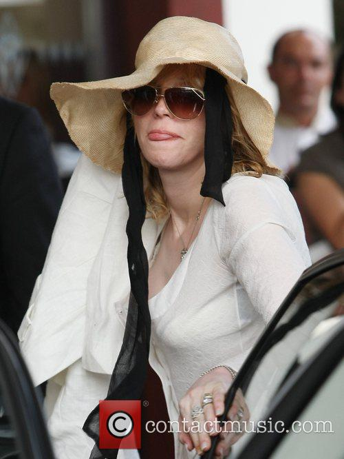 Courtney Love Celebrities leaving the Martinez Hotel during...