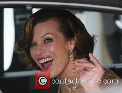 Milla Jovovich Celebrities leaving the Martinez Hotel during...