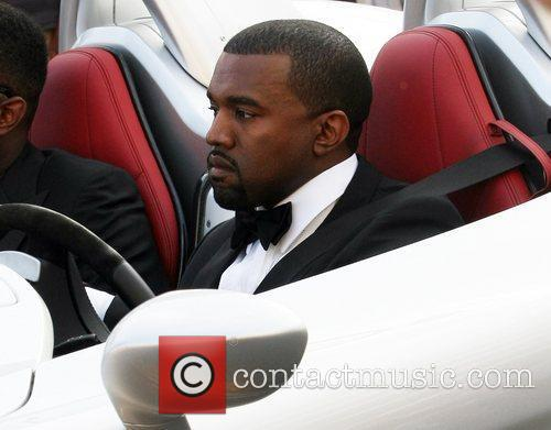 Kanye West Celebrities leaving the Martinez Hotel during...