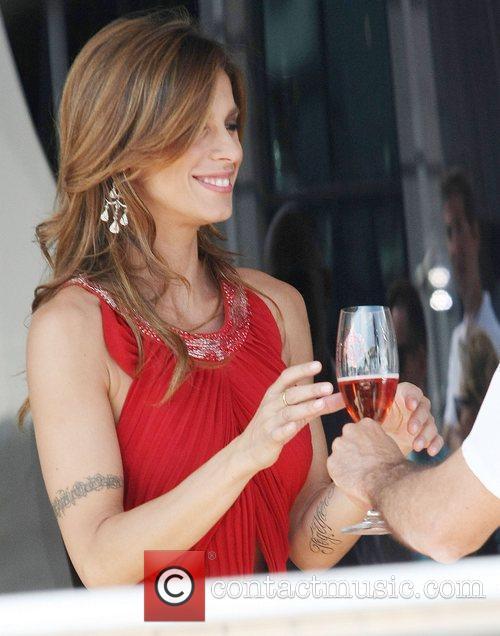 Elisabetta Canalis relaxes on Roberto Cavalli's luxury yacht...
