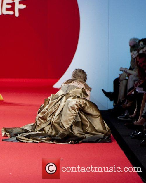 A model falls over for the third time...