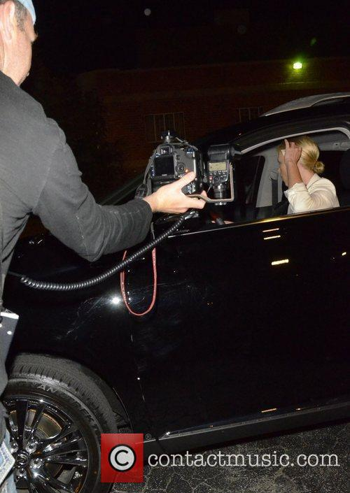Charlize Theron is surrounded by photographers as she...