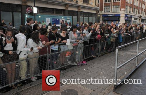 Cher Lloyd greets fans outside the Radio One...