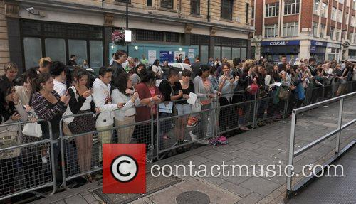 Atmosphere Cher Lloyd greets fans outside the Radio...