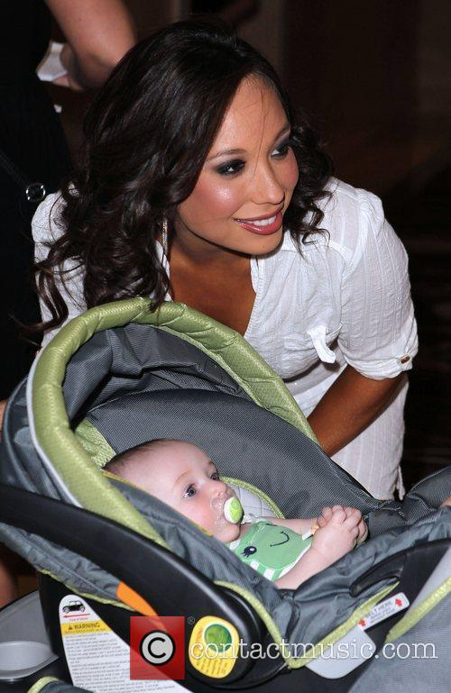 Cheryl Burke posing with a baby Professional dancer...