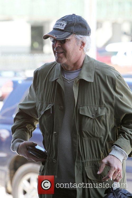 Chevy Chase seen arriving at LAX to catch...