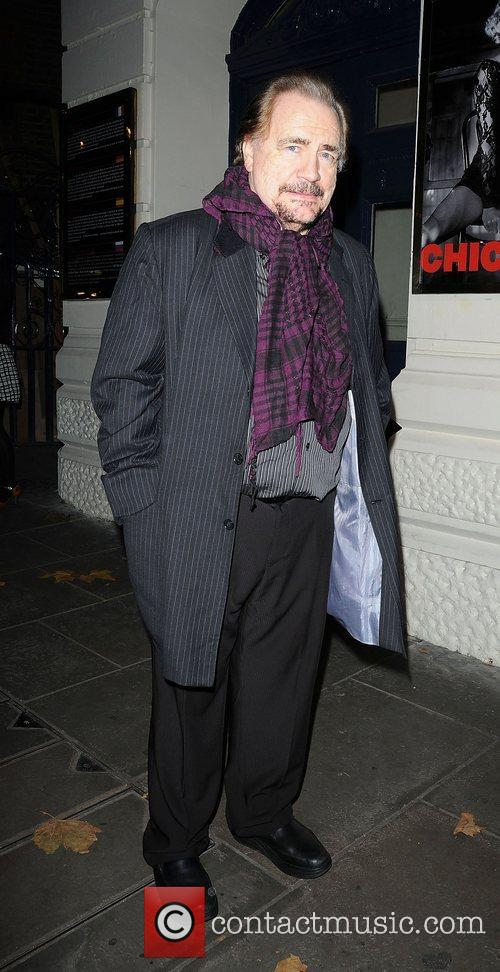 Leaves the Garrick Theatre after attending the press...