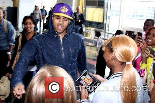 Chris Brown  with fans after arriving at...