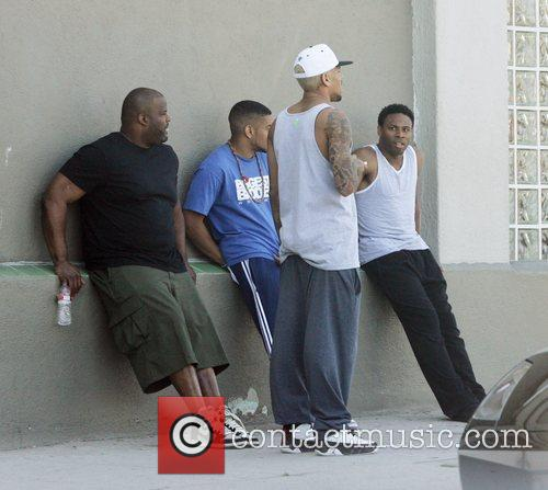 Chris Brown chats to friends outside a recording...