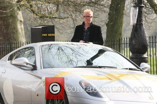 Chris Evans  parks his Ferrari outside the...