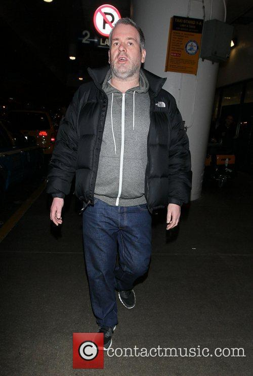 Chris Moyles arrives at LAX airport on an...