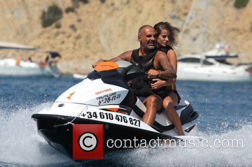 Christian Audigier and his girlfriend Nathalie Sorensen take...